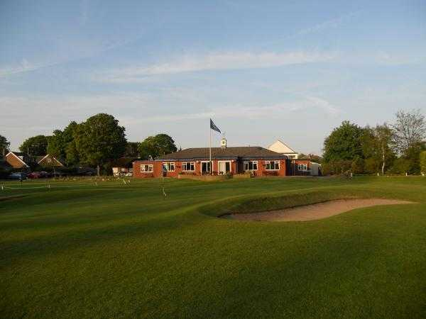 A view of the 18th green and clubhouse in background at Widnes Golf Club