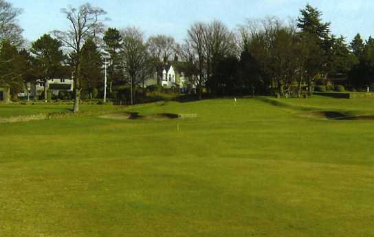 A view of green protected by bunkers at Hallowes Golf Club