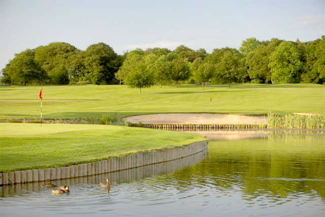 A view of green surrounded by water at Morley Hayes Hotel & Golf