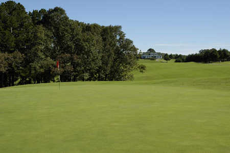 A view of the 1st hole with the clubhouse in the background at Apple Mountain Resort.