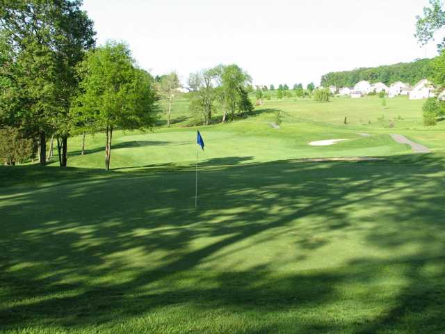 A beautiful view of the fairway and green from Pilgrim's Oak Golf Course