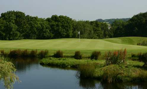 A view over the water of green at Woodbury Park Hotel & Golf Club