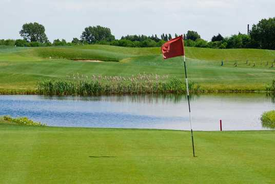 A view of the 4th green with water in background at Burstwick Country Golf