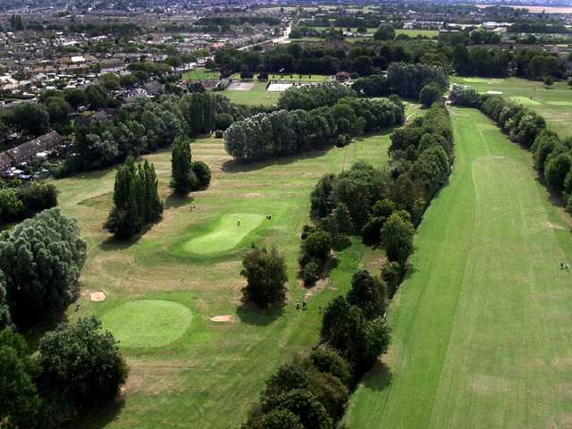 Aerial view above the 14th tee looking back down the 13th fairway with green #11 and #9 on the left side at Springhead Park Golf Club