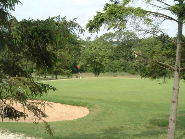 A view of green guarded by bunker at Forrester Park Golf & Country Club