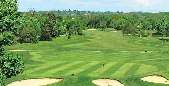 A view of a green protected by bunkers at Romford Golf Club