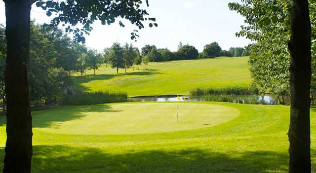A view of a green with water coming into play at Brentwood Golf Club