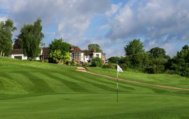 A greenside view of the clubhouse at Addington Court Golf Centre