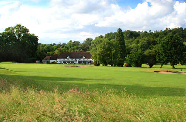 A view of the 10th green with clubhouse in background at Croham Hurst Golf Club