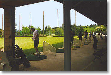 The driving range is covered and lighted. Since the range runs slightly downhill, trampoline greens have been placed at some yardage markers so golfers know where their ball has landed.