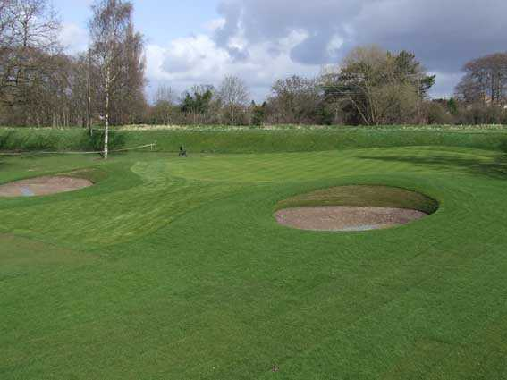 A view of green guarded by bunkers at Didsbury Golf Club