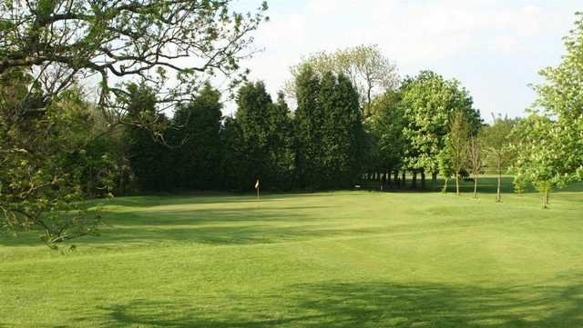 A sunny view of a green at Flixton Golf Club