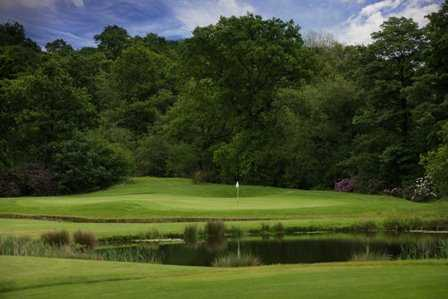 A view over the water of green at Marriott Worsley Park Golf Club