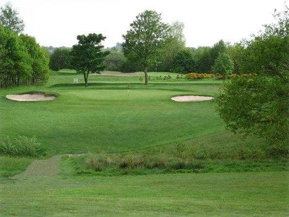 A view of the 11th green flanked by bunkers at North Manchester Golf Club