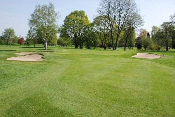 A view of the 12th green protected by sand traps at Northenden Golf Club