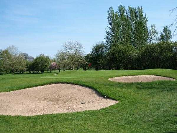 A view of hole #14 at Northenden Golf Club