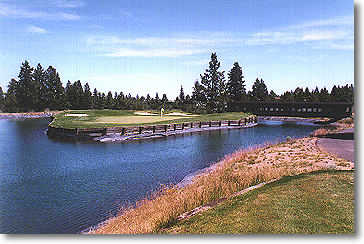 Hole #16: Unique hole with the railroad dining car bridge. Water surrounds this hole completely with bunkers guarding the back and left.