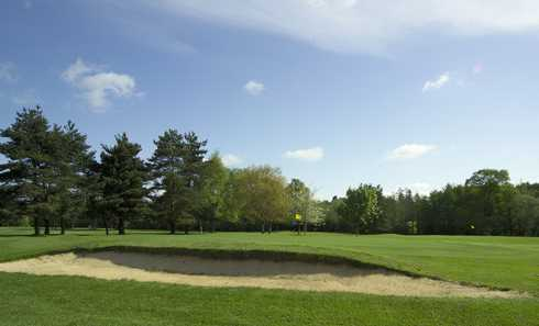 A view of green protected by sand trap at Bramshaw Golf Club