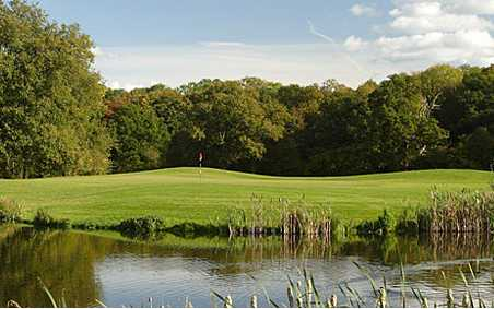 A view over the water of a green at Sherfield Oaks Golf Club