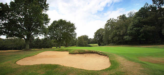 A view of hole #7 guarded by bunker at Stoneham Golf Club