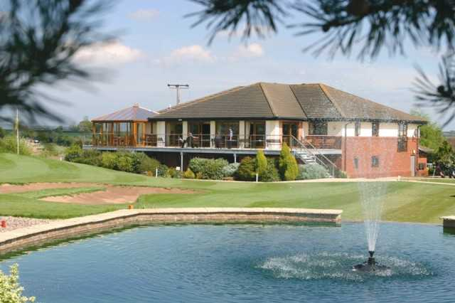 A view of the clubhouse with water fountain in foreground at Sapey Golf Club