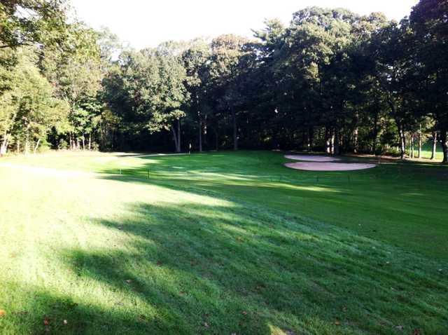 A view of the green an bunkers at Dix Hills Park Golf Course
