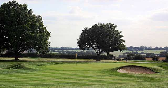 A view of the 13th green with bunker on the right side at Mid Herts Golf Club
