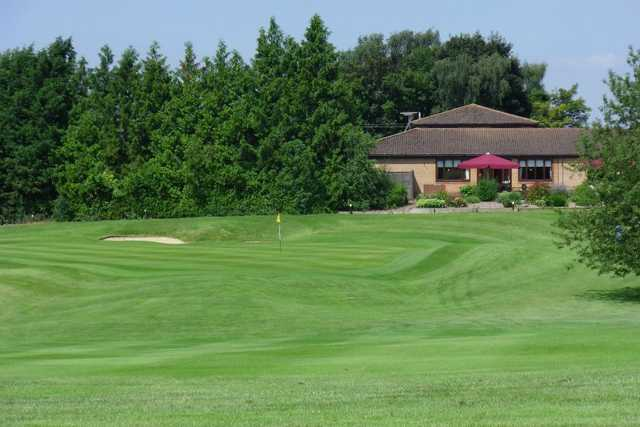 A view of a hole with clubhouse in background at Ver Course from Redbourn Golf Club