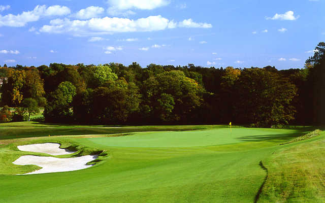 A view of a green guarded by bunkers at Grove Golf Club