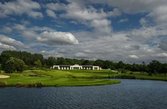 A view over the water of the clubhouse at Shire London