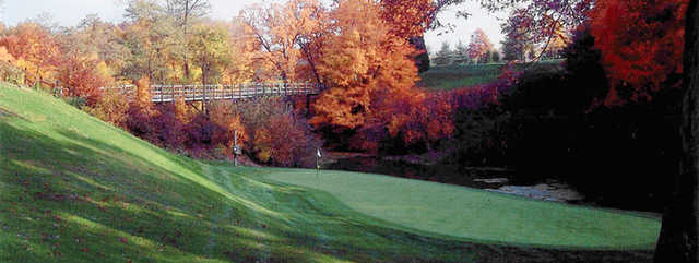 Autumn view of a green at Ridge Top Golf Course