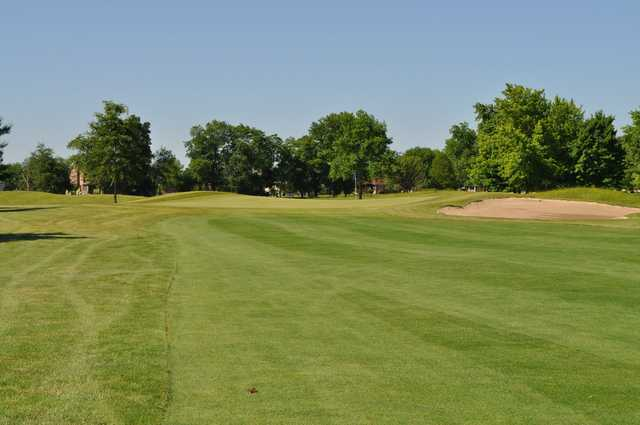View of a green and bunker at Hawk's Tail of Greenfield