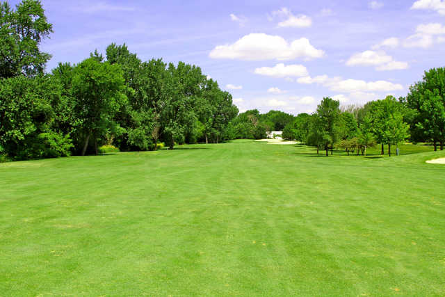 View of the 4th fairway and green in the background at River Bend Golf Course