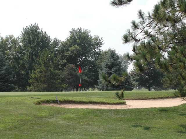 View of a green and bunker from the East course at Fox Prairie Golf Club