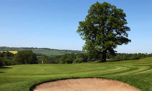 A view of hole #7 guarded by bunker at Westerham Golf Club