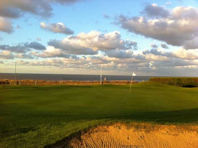 A view of a green with water in background at Westgate & Birchington Golf Club