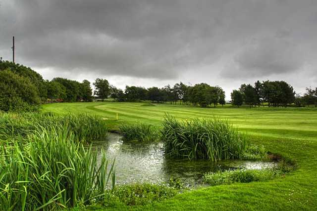 A view over the pond of the 9th fairway at Baxenden & District Golf Club