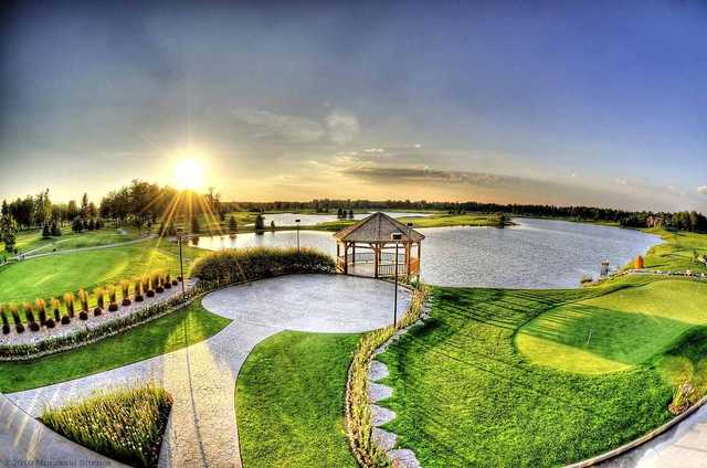 Sunset view of the gazebo and lake at Solitude Links Golf Course & Banquet Center