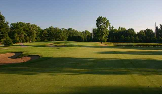 View of the 11th fairway and green at Sandy Pines Golf Club