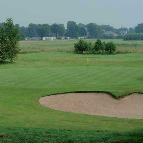 A view of a green guarded by bunker at Myerscough Academy Golf Course