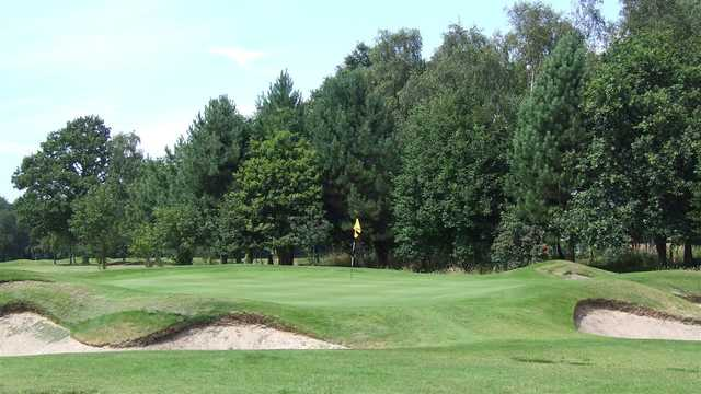 A view of a green surrounded by bunkers at Ormskirk Golf Club