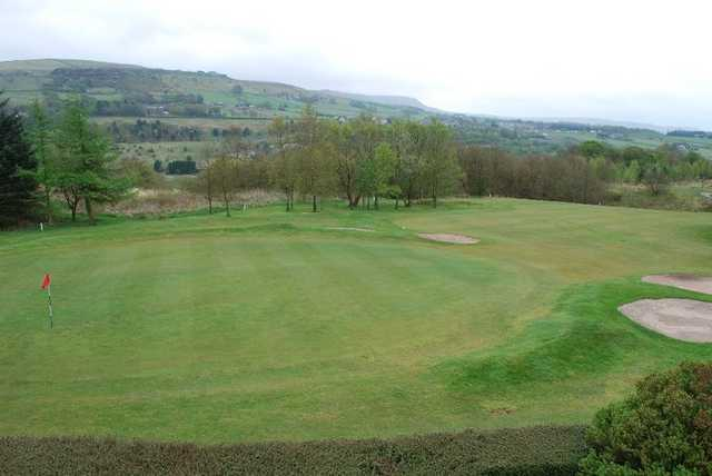 A view of a green guarded by bunkers at Rossendale Golf Club