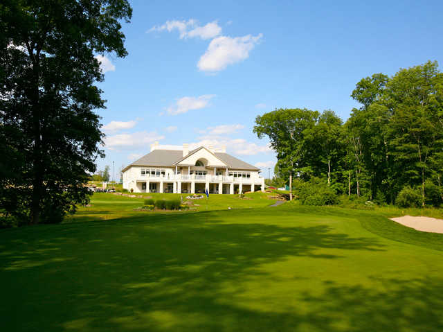 View of a green with the clubhouse in the back at Great Bear Golf Club
