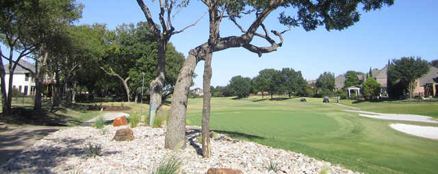View of a green and bunker at Firewheel Golf of Garland