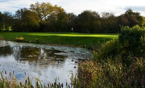 A view over the water of a green at Belton Woods Golf Club