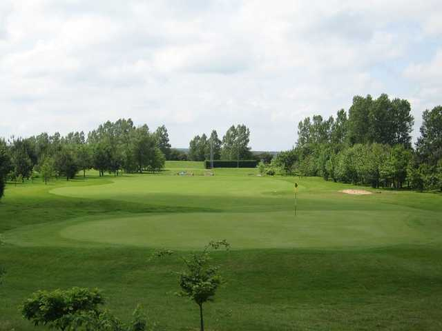 A view of a green at Championship Course from Grange Park
