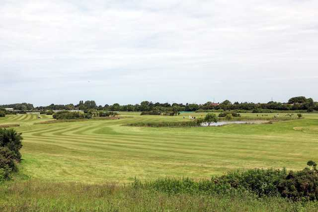 Scenic views of the 5th and 8th fairways and pond at Aintree Golf Centre