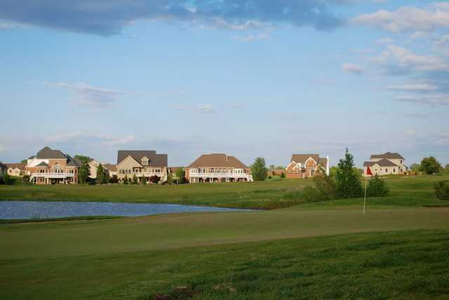 View of a green and lake at Copper Ridge Golf Course