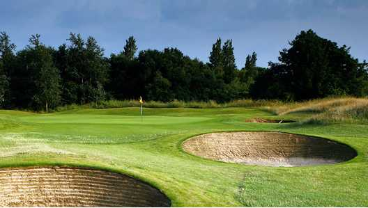 A view of the 4th green guarded by bunkers at Hesketh Golf Club