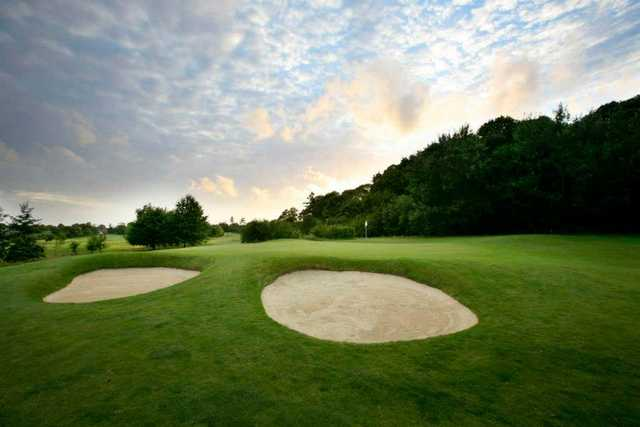 A view of a green guarded by bunkers at Marriott Sprowston Manor Country Club